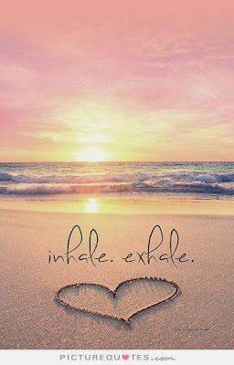 """Inhale. Exhale."" Picture of a heart made of stones on a beach with the sun rising in the background. picturequoets.com"