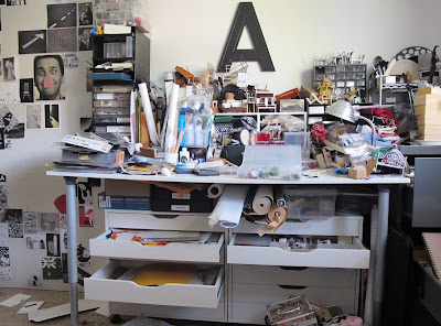 Work table of a miniature artist, in a complete mess.