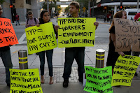 Union members and community activists protest the Trans-Pacific Partnership in Miami in March. (Credit: Joe Raedle/Getty Images) Click to Enlarge.