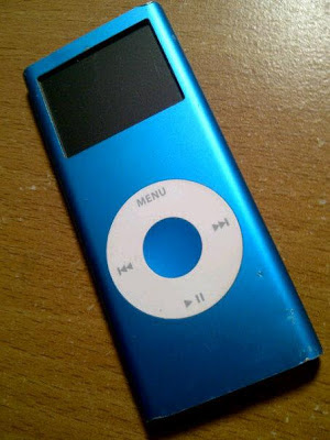 """""""Mystery iPod"""" © Laura Sheana Taylor, 2012. Metallic blue iPod. I scored this for five bucks at a garage sale. But what if its contents are worth way more?"""
