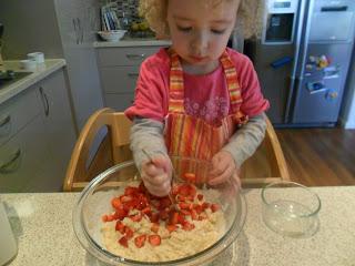 Adding chopped strawberries to Strawberry Muffin recipe