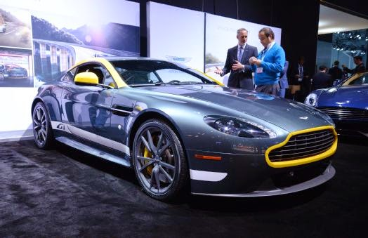 """Aston Martin Shows DB9 Carbon Edition, V8 Vantage GT in New York Aston Martin is bringing two special-edition models to the New York auto show: the Aston Martin DB9 Carbon Edition and V8 Vantage GT. We've seen both cars before in Geneva, though the Vantage has now been renamed """"GT"""" from N430 for the U.S. market. As we said previously, the Carbon Edition adds carbon fiber accents and an overall dark color scheme to the DB9, while the V8 Vantage GT gets racing-inspired goodies and a power bump over the standard V-8 model. For the U.S., the Vantage GT has a price tag of just over $100,000.  The Carbon Edition relies on the same 510-hp 6.0-liter V-12 found in other DB9 models, and comes mated exclusively with a six-speed automatic transmission. Where it stands apart from its lesser DB9 siblings is its carbon fiber exterior and interior treatment. Carbon fiber side strakes and taillight accents adorn the special model's sheetmetal, along with black meshes and window surrounds. Optional accents include a carbon fiber front splitter, rear diffuser, and mirror caps. The Carbon Edition rides on 10-spoke diamond-turned alloy wheels offered in either satin black or silver. Brake calipers can be had in red, yellow, black, or gray finishes. The predominantly black theme continues inside with carbon fiber details and a choice of accent colors. The interior also gets unique door sill plaques with the Carbon logo.  The Vantage GT draws inspiration from Aston's motorsports past and present, with the Vantage GT4 race car named as one of its main styling influences. The car gets dark-themed exterior accents, including graphite-finished and diamond-turned alloy wheels, black headlight bezels and side window surrounds, and black textured exhaust tips. A graphics package is available, allowing owners to dress up their Vantage GT like the Le Mans-winning DBR1 or DB2/4. Contrasting graphics can be added to the grille, mirror caps, A-pillar, and rear diffuser.  Aston Martin V8 Vantage Gt Fr"""