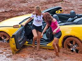 Girls cars playing in mud