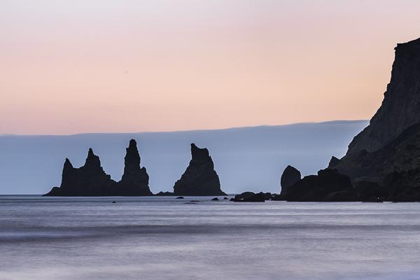 the basalt sea stacks Reynisdrangar at twilight