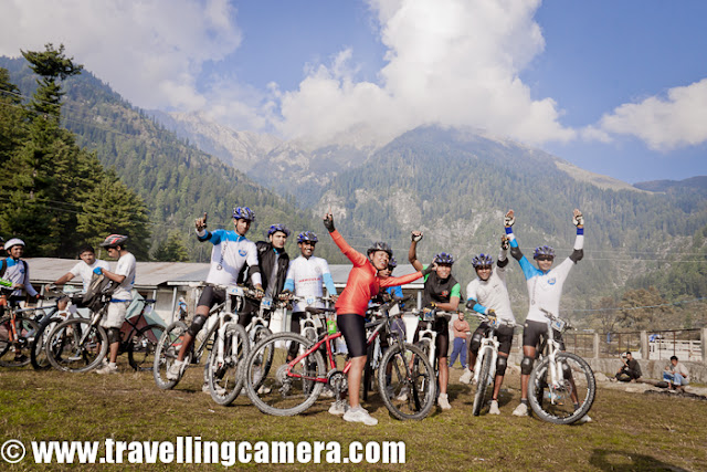 After full day rest at Kullu Sarahan, it was time for get ready for next journey towards Jalori Pass and back to Shimla via Dhomri (Narkanda) ... All the riders were comparatively more energetic and passionate about the stages of MTB Himachal !!! Here is a small PHOTO JOURNEY of 5th day morning, when we had to move towards Bahu !!!It was right time to have some clicks of these riders at this beautiful camping site of Kullu Sarahan... But there was no one to co-ordinate and I was not in a mode to pull each of the rider and ask them to say cheeze... So captured some of them who were around the place...Warm-up sessions at Kullu Sarahan, during Mountain Terrain Biking, Himachal Pradesh-2011 Suddenly more folks from Nepal team, Army group and Noida gang joined in and happily cheering for our next journey of Mountain Terrain Biking Himachal 2011...Here come the Army team and Monika hopping in with big cheer for the team !!!Route of Day-5 of Mountain Terrains Biking, Himachal Pradesh, 2011 was ::Bagipul == Urtu == Garshaain == Damah == Kandagahi == Amarbaag == Chuaai ==Shamshar == BaahoSudhir, Vikas, Gouri and Siddhartha - The Noida Gang at Mountain Terrain Biking, Himachal Pradesh, 2011 !!!Our own, Mr. Darshan Singh Ji... He was comfortably dragging his cycle on this bridge and picked it up after seeing the Travelling-Camera !!!This lady was here to participate and had come with her little baby. During day time, one of her relative used to take care of this baby. She used to find some time during free stages to meet him and make sure that everything is fine. Unfortunately on last day, baby had very high fever and she had to quit the race in between.Sarahan goats are coming towards our camps to wish good luck for next journey of MTB Himachal 2011 !!Ohh.. Here are our Marshals !!! Arjun had posed for his photograph but most of us were not aware that why he is standing like this :) ...Finally he got this opportunity of posing again.. that's too with black ScorpiowithOfficial sticker on it :) ... Yo Man !!!Mr. Gagan also wanted to have a similar shot but Arjun also chipped in :)