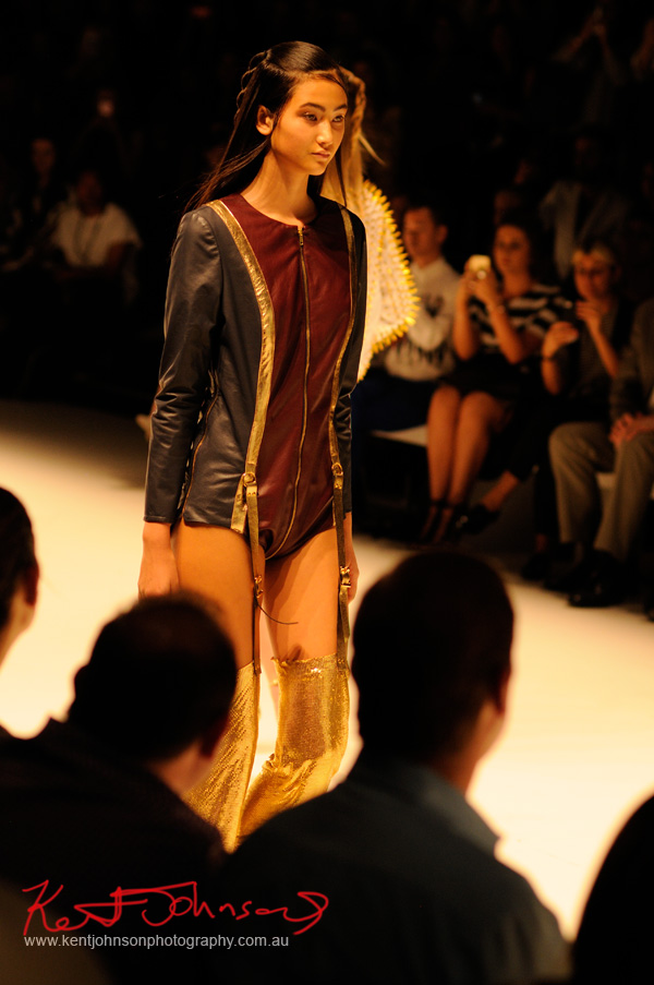 Leather play-suit with gold-lamé leggings on bondage style suspender straps. ANY STEP by Amy Le and Stephanie McGuigan - MBFWA - Photographed by Kent Johnson.