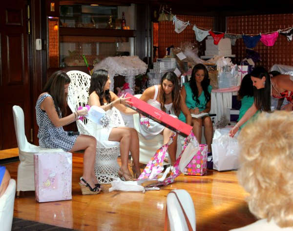 her bridesmaids set up an assembly line of gift opening that can only be described as nothing short of spectacular maria opened up dozens upon dozens of
