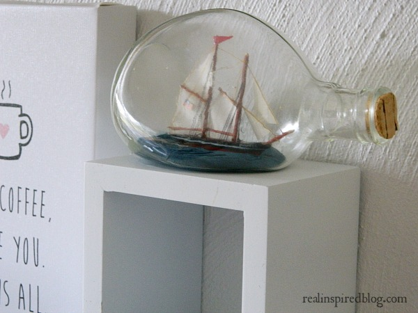 An Ocean Themed Office Gallery Wall-ship in a bottle