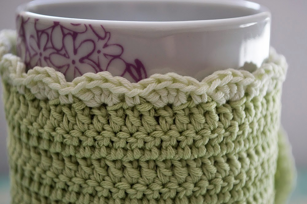 Borde funda verde de ganchillo para taza
