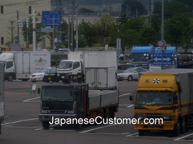 Japanese Trucks wait to board, Japan Copyright Peter Hanami 2014
