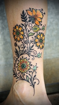 Small yellow flower tattoos on leg