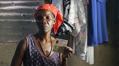 Cecillia Pie shows her old and new Dominican identification cards.  Celia was part  of a group of 27 Dominicans of Haitian descent who were detained and forcibly  removed to the border town of Jimani in January 2015, in  the Bahoruco province. (Oriol Estrada)