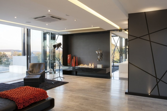Photo of modern bedroom with the fireplace