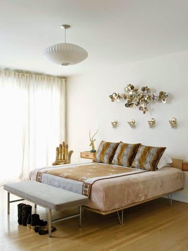 Escultura dorada vintage de pared dormitorio