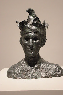 Photo of sculpture exhibit by Picasso.  It is a bust of a Jester