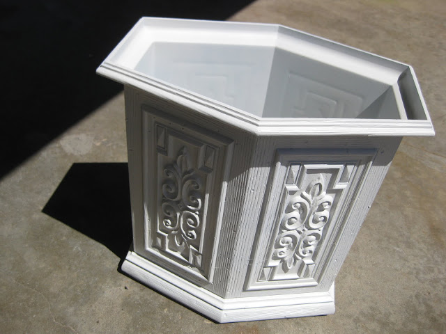 Start the DIY glazing and antiquing process by priming the whole surface.