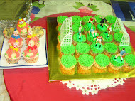 FOOTBALL AND CLOWN CUP CAKE
