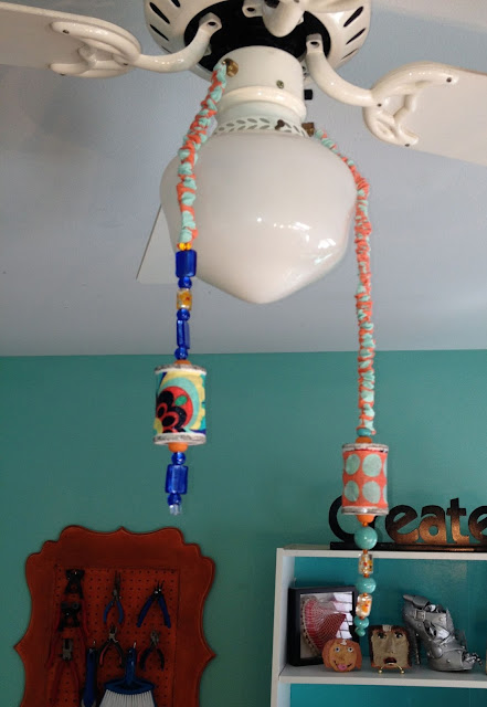 Fan pulls for my craft room...wood spools and beads.