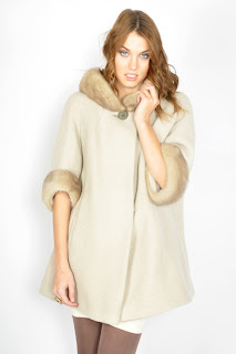Vintage 1960's creme colored wool coat with mink collar and cuffs and button front closure.