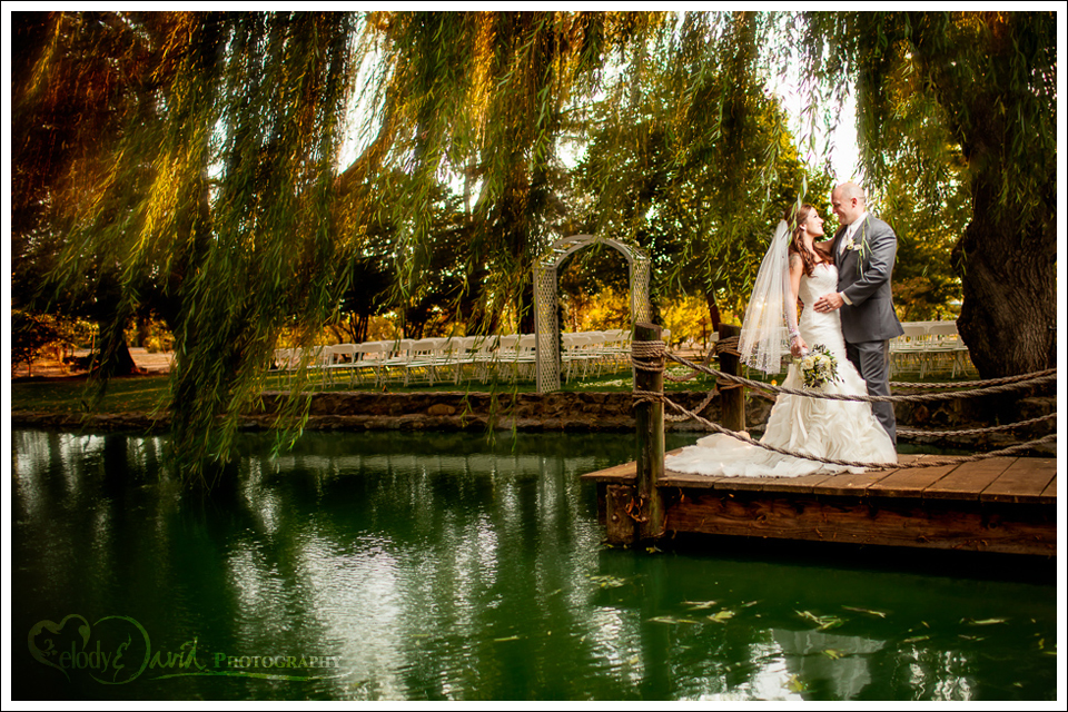 Bride and groom on dock at Mettler Family Vineyards