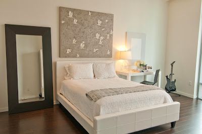 elegant and simple bedroom with minimum clutter is furnished in neutral hues and natural accent