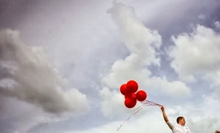 There is no life as complete as the life that is lived by choice  - happy man balloons holding carrying