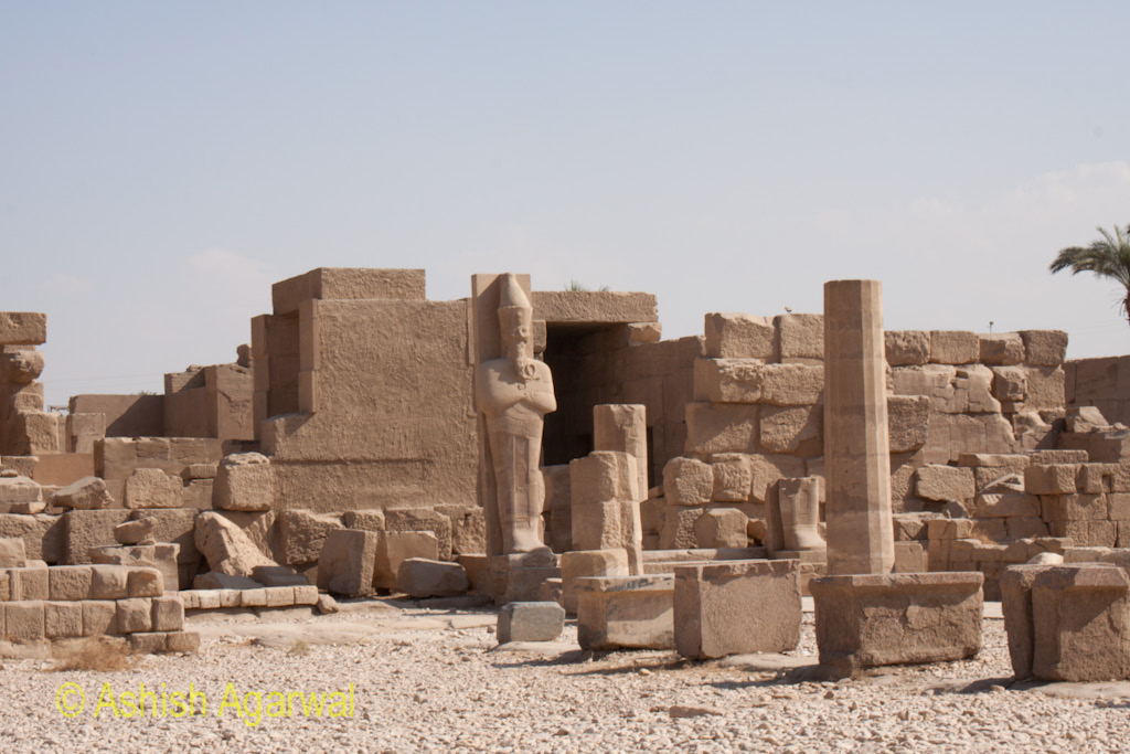 Statue of a pharaoh and other damaged items inside the Karnak temple