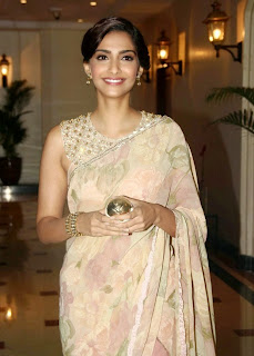 Sonam Kapoor in Lovely Flowr Print Designer Saree and a Backless Pink Gown