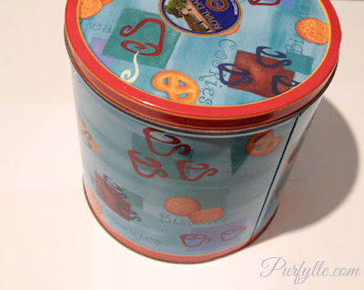 Deep cookie tins will hold LOTS of clutter. I love tins.