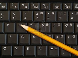 A picture of a pencil on a computer keyboard