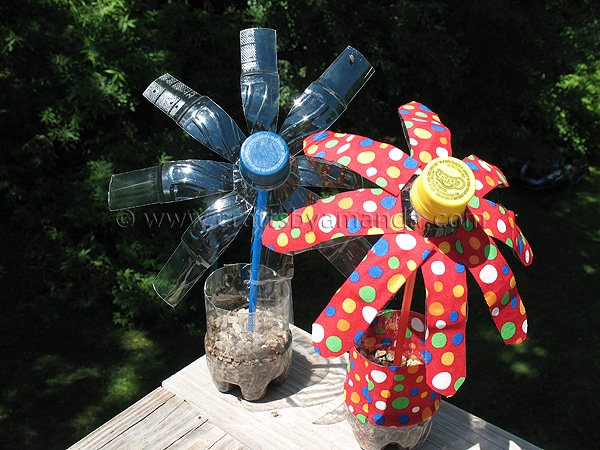 Plastic water bottle flowers crafts by amanda for Water bottle recycling ideas