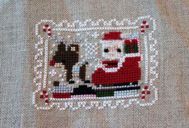 Frosted Pumpkin Stitchery - Santa cross-stitch
