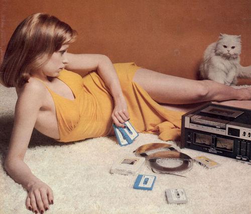 Sensual Woman Listening Music On Old Radio Stock Photo