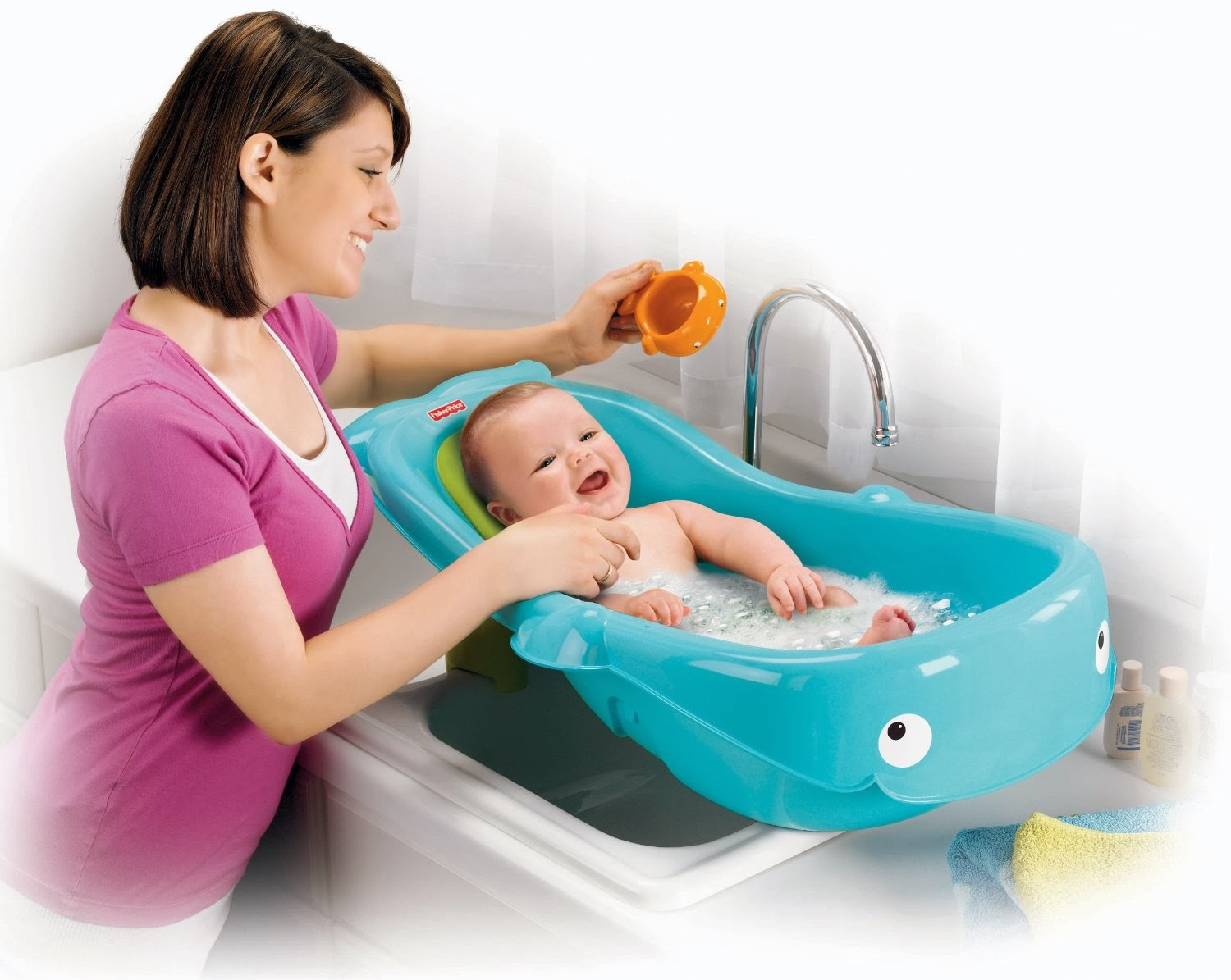 Baby bath chairs for the tub - Baby Will Have A Whale Of A Good Time In This Adorable Bath Center That Grows From Infant To Toddler A Contoured Baby Stopper Insert Keeps Your Infant
