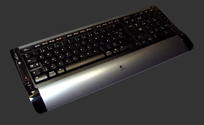[Image: Photo of a black cordless QWERTY keyboard with a Logitech logo.]