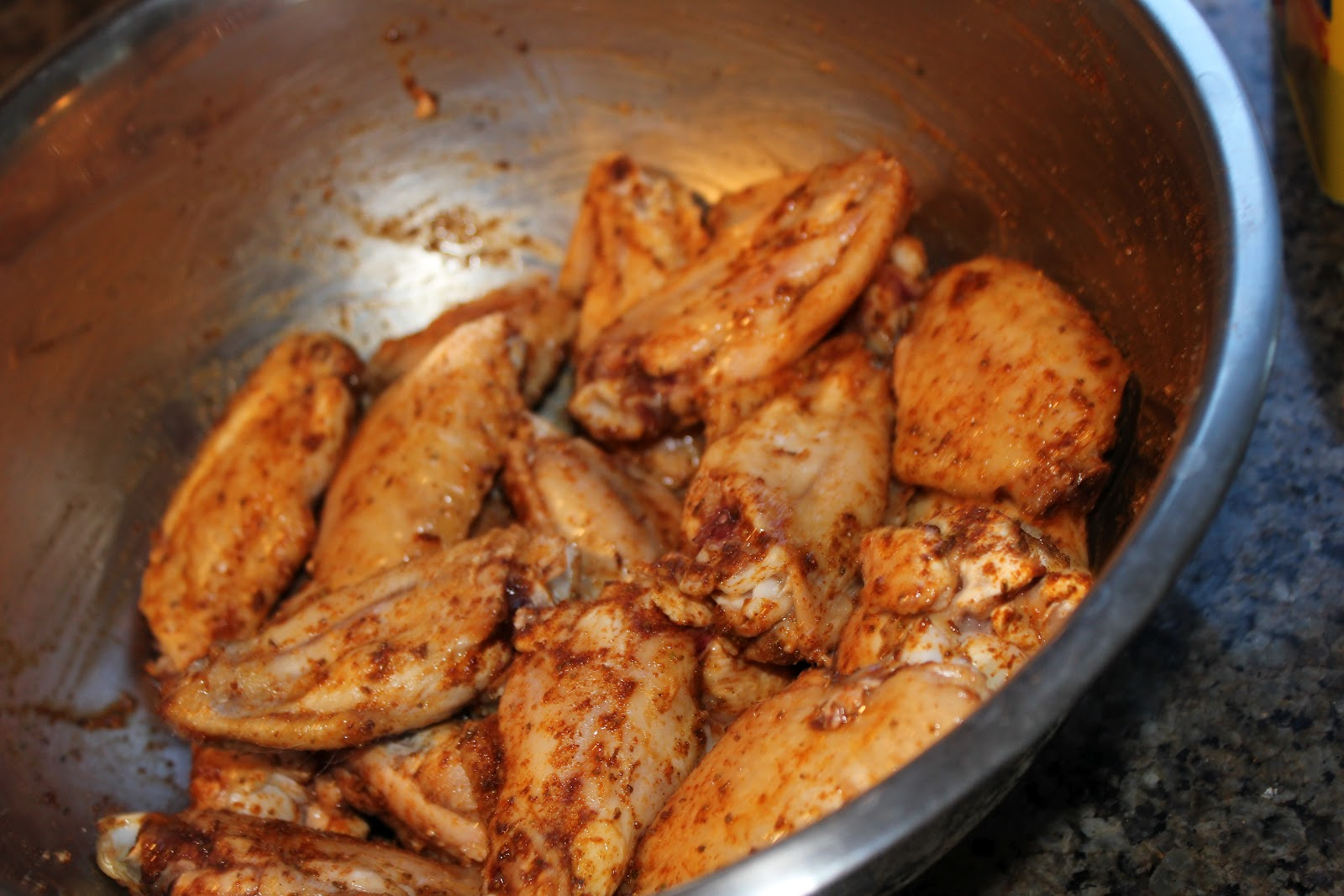 Put wings in a bowl and cover generously with Old Bay, using as much ...