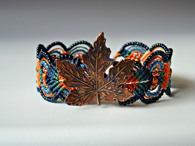 Micro macrame bracelet in orange and blue with copper leaf.