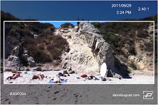 rock on beach through lens 1