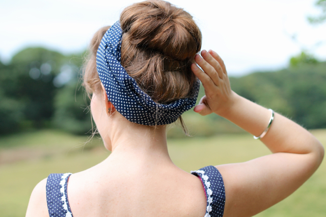 Navy and white polka dot top with matching headscarf