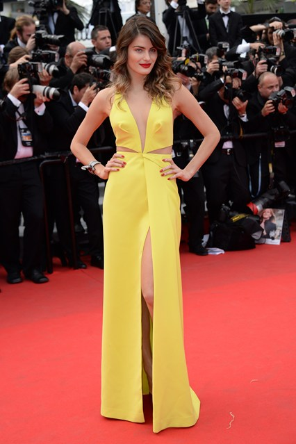 Isabeli Fontana in a custom-made yellow Tufi Duek gown with red Louboutin shoes at Cannes 2014