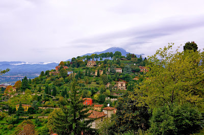 Image of houses and tress on a hill near Bergamo, Italy.