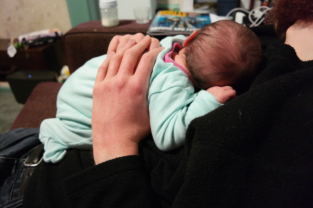 Matilda held in Steve's hands