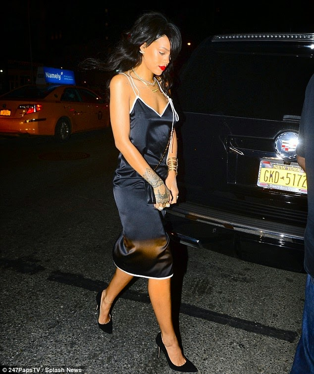 Rihanna steps out in a slinky black satin Adam Selman slip dress in New York