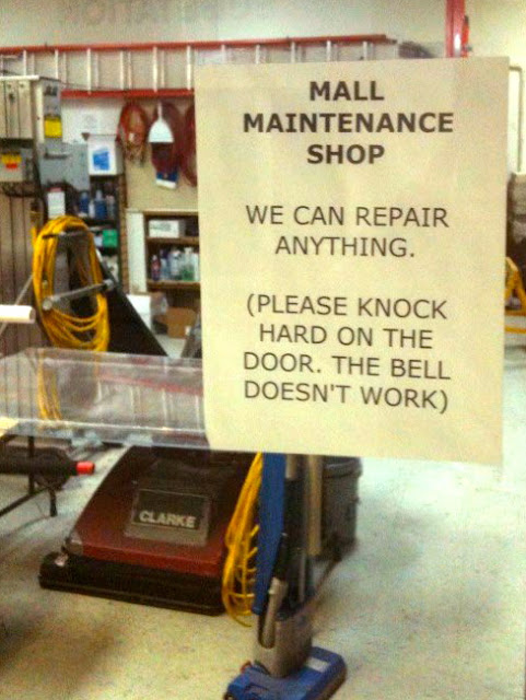 funny store sign - we can repair anything except our door bell