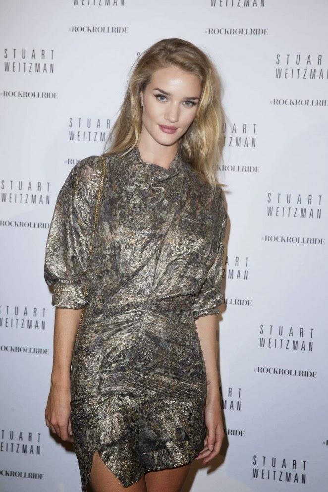 Rosie Huntington-Whiteley flaunts a metallic Isabel Marant dress at the Stuart Weitzman Cocktail Party for #rockrollride Paris premiere