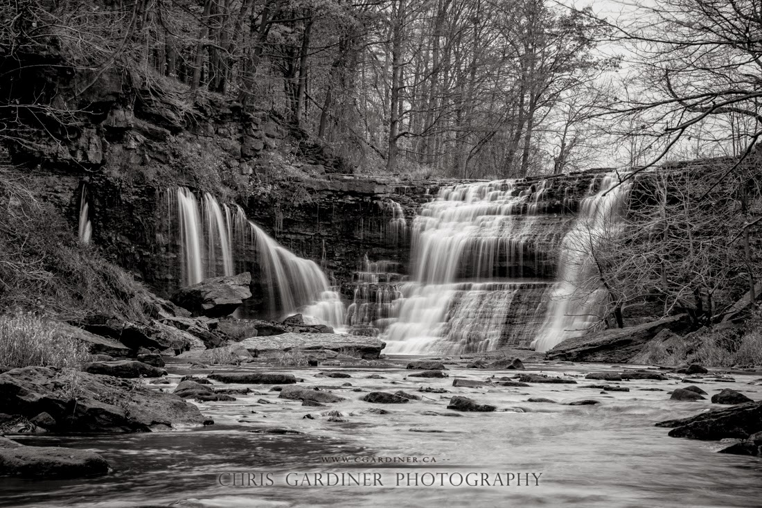 Scenic view in monochrome black and white of the Upper Balls Falls in southern Ontario along the Niagara Escarpment and Bruce Trail captured by Chris Gardiner Photography