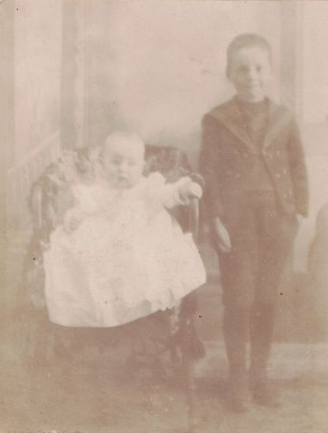Unidentified boy and baby in album of Mary Frances Jollett Davis, Page County, Virginia
