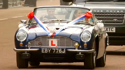 The newlyweds drive off as Learners in an Aston Martin. YouTube 2011.