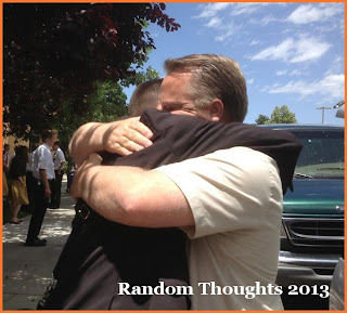 Father hugs tightly his leaving son for a mission
