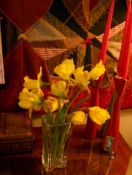 Things I like: Daffodils, my mom's Danish Candlesticks and old Quilt